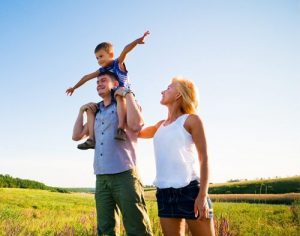 Parents with Child outdoors enjoying peace of mind
