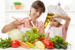 mom and daughter cooking healthy foods